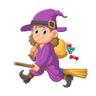Wiedźma z magiczną miotłą wyrzuca cukierki z worka ilustracji