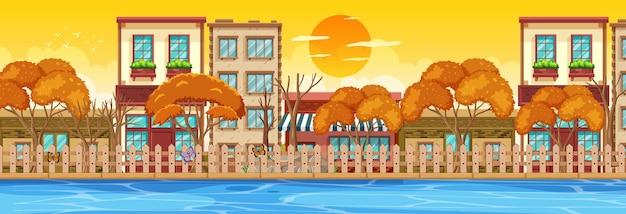 Wiele budynków wzdłuż poziomej sceny rzeki o zachodzie słońca