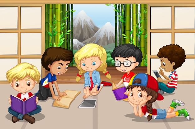Wiele dzieci czyta w pokoju