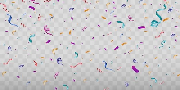 Wiele kolorowych malutkich konfetti i wstążek na przezroczystym