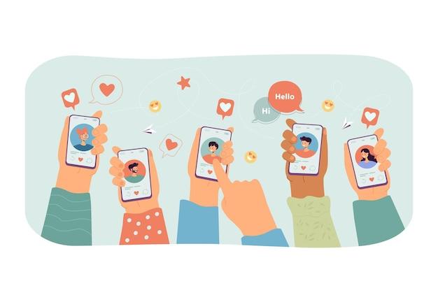 Wiele rąk trzymających smartfony z aplikacją randkową na ekranie