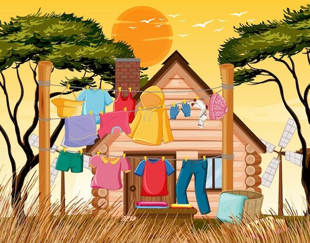 Wiele ubrań wiszących na linii poza sceną domu