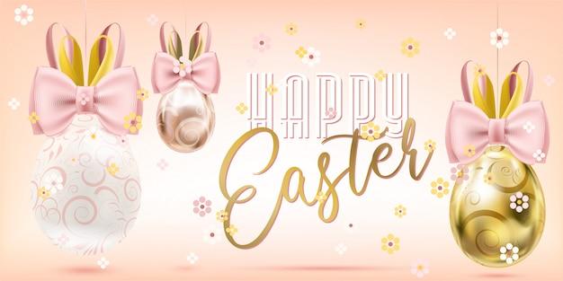 Wielkanoc dekorujący złoci jajka z królika łękiem