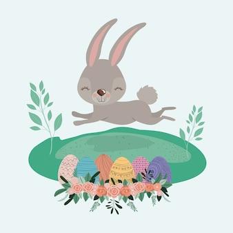Wielkanoc krajobrazowa scena z królikiem i easter jajkami