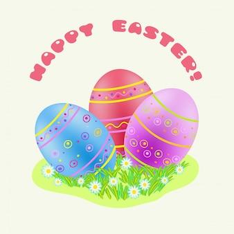 Wielkanoc niebieski; czerwony; fioletowe jajko malowane w zielonej trawie