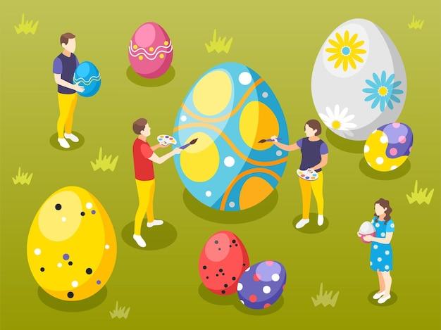 Wielkanocna izometryczna ilustracja z widokiem trawiastego trawnika z ludzkimi postaciami malującymi duże jajka za pomocą pędzli