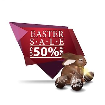 Wielkanocna sprzedaż, różowy sztandar z czekoladowym wielkanocnym królikiem