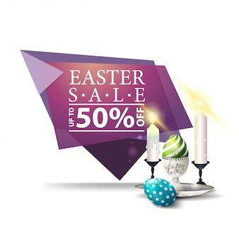 Wielkanocna sprzedaż, różowy sztandar z wielkanocnymi jajkami i świeczkami