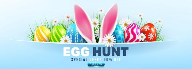 Wielkanocna sprzedaż sztandar z wielkanocnymi jajkami i kwiatem