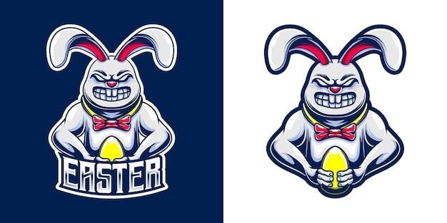 Wielkanocne logo maskotki z króliczkiem i złotym jajkiem