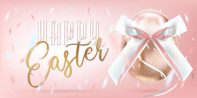 Wielkanocne spojrzenie jajko z różowym jedwabniczym łękiem i confetti