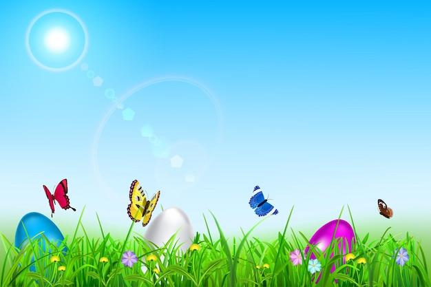 Wielkanocne tło z niebem, słońcem, trawą, pisanki, kwiaty i motyle