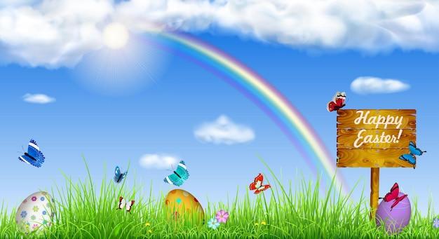 Wielkanocne tło z niebem, słońcem, trawą, tęczą, pisanki, motyle, kwiaty i drewniany wskaźnik