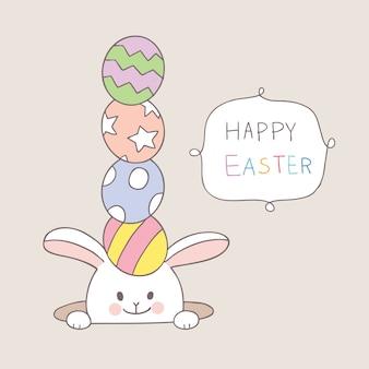 Wielkanocnego dnia królik z kolorowymi jajkami
