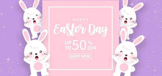 Wielkanocny dzień transparent z słodkie króliki w ogrodzie. cięcie papieru i styl rzemiosła.