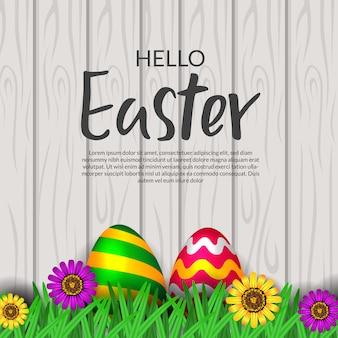 Wielkanocny jajko z kwiatu okwitnięciem z drewnianym tłem