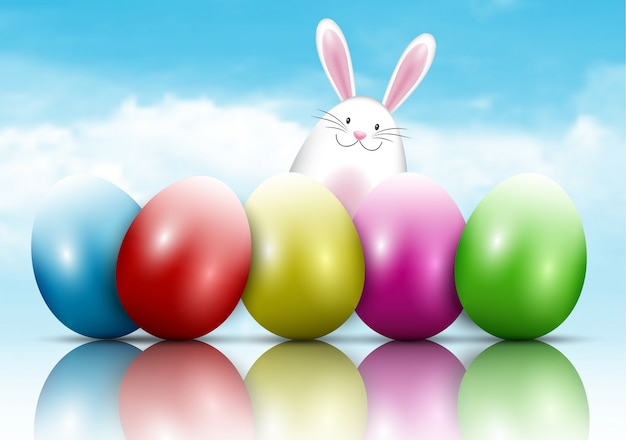 Wielkanocny królik i jajka na niebieskiego nieba tle