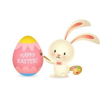 Wielkanocny królik maluje jajko