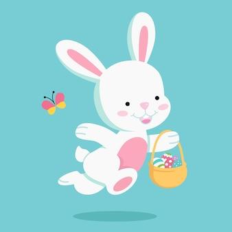 Wielkanocny królik niosący wielkanocny kosz