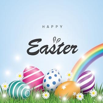 Wielkanocny wakacyjny tło z kolorowymi wielkanocnymi jajkami, trawą i białym kwiatem