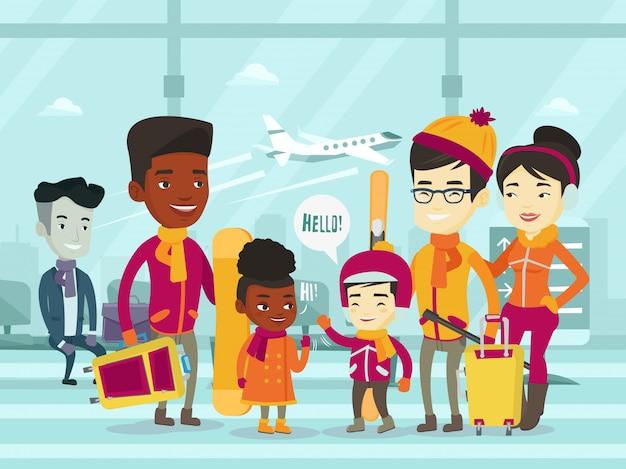 Wieloetniczni turyści stoi w lotnisku w zimie