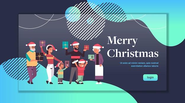 Wielopokoleniowa rodzina z pudełkami prezentowymi stojącymi razem wesołych świąt szczęśliwego nowego roku koncepcja uroczystości dziadkowie i dzieci w czapkach mikołaja na całej długości pozioma kopia przestrzeń wektor ilus