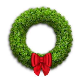 Wieniec bożonarodzeniowy z gałęzi jodłowych, czerwona kokarda ze wstążkami. noworoczny wystrój domu.