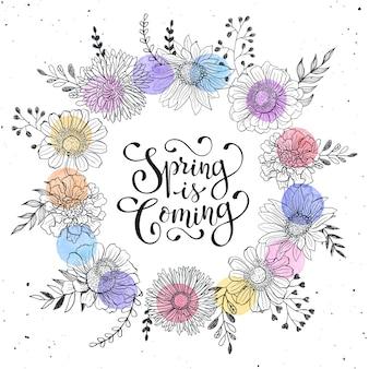 Wieniec kwiatowy z wiosną nadchodzi tekst. ręcznie rysowane kwiaty i plamy akwarela