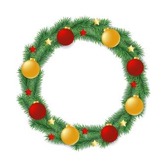 Wieniec wykonany z gałęzi drzewa wiecznie zielonego w kształcie koła ozdobionego kulkami i gwiazdami.