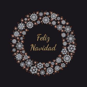 Wieniec ze złotymi błyszczącymi napisem feliz navidad