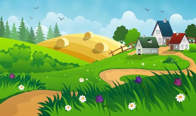 Wieś krajobraz z sianem, polem i małą wioską.