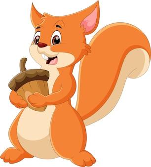 Wiewiórka kreskówka trzymając nakrętkę