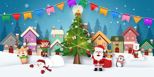 Wigilia ze świętym mikołajem i przyjaciółmi w śnieżnym miasteczku