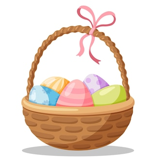 Wiklinowy koszyk wielkanocny z malowanymi jajkami.
