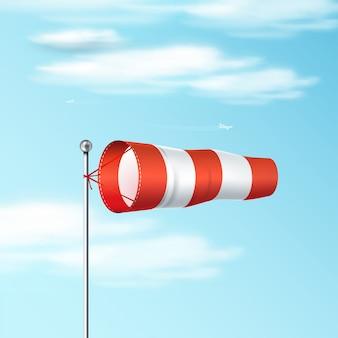 Windsock na niebieskim niebie. czerwona i biała flaga wiatrowa lotniska pokazuje kierunek i prędkość wiatru. realistyczna ilustracja.
