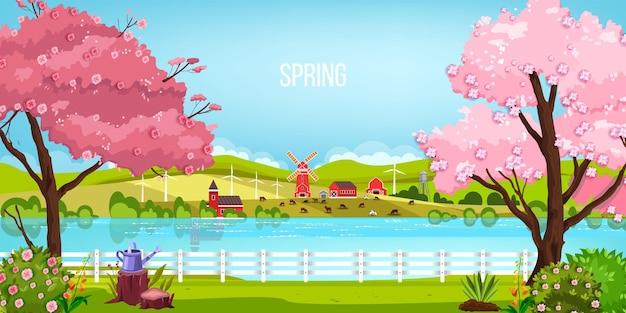 Wiosenny krajobraz z rzeką, kwitnącymi drzewami sakura, młynem, łąką i wzgórzami.