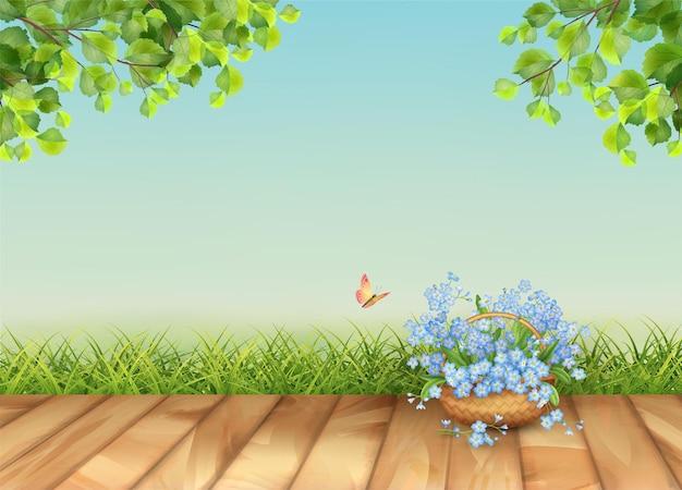 Wiosenny krajobraz z trawą i pięknym bukietem w wiklinowym koszu