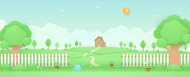 Wiosna czas krajobraz dom na wzgórzu ogród z drzewami kwiaty konewka na trawie