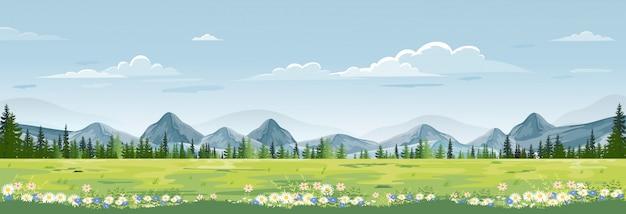 Wiosna krajobraz z górami, błękitne niebo i chmury, panorama zielone pola, świeża i spokojna wiejska przyroda na wiosnę z zieloną trawą