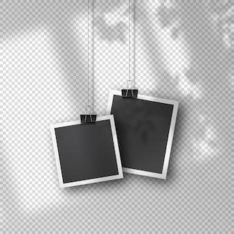 Wiszące zdjęcie w stylu vintage na miękkim przezroczystym tle. realistyczne szablony zdjęć retro zawieszone na metalowych klipsach. miękka organiczna nakładka cienia z okna i otoczenia.