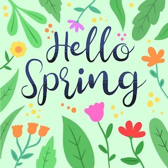 Witaj wiosenny napis otoczony liśćmi