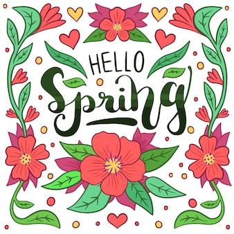 Witaj wiosna napis z czerwonymi kwiatami i liśćmi