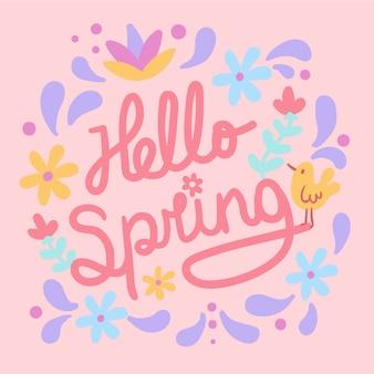 Witaj wiosna napis z żółtym ptaszkiem i kwiatami