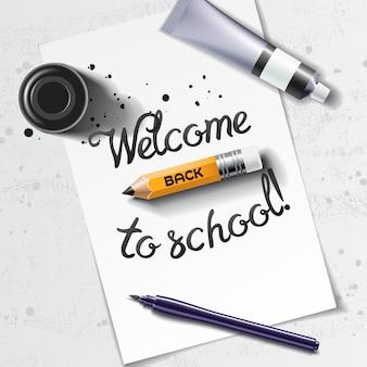 Witaj z powrotem do szkoły ręcznie rysowane napis z makietą kaligrafii z pędzelkiem