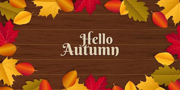 Witam jesień ilustracja z rozrzuconymi jesiennymi liśćmi