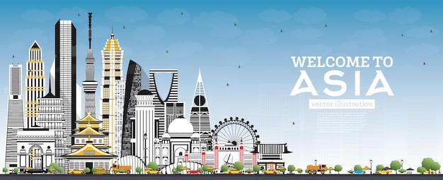 Witamy w asia skyline z szarymi budynkami i niebieskim niebem.