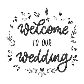 Witamy w naszym godle z napisem ślubnym. ręcznie wykonane elementy zaproszenia na ślub. ilustracja. nowoczesna kaligrafia