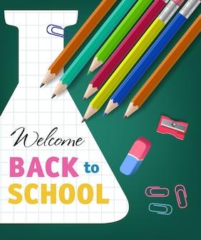Witamy z powrotem w szkolnym napisem z ołówkami i retortą