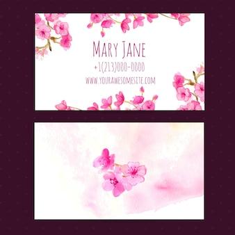 Wizytówka szablon wektor z różowymi kwiatami wiśni. akwarela ilustracja.