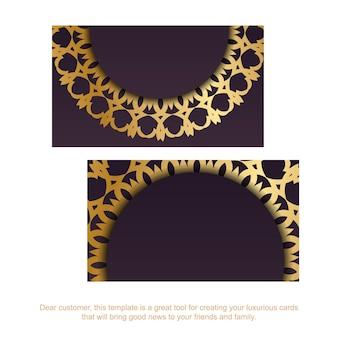 Wizytówka w kolorze bordowym z wzorem greckiego złota na kontakty.